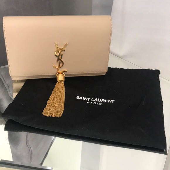 43f55e070b YSL Kate Monogram Tassel Wallet on a Chain. M 5adf50f38290af7181aa4ffc.  Other Bags you may like. YSL Saint Laurent ...